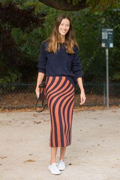 A midi-length pencil skirt gets a little edge with a bright-white sneaker. Dries Van Noten skirt.