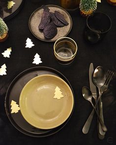 Xmas table styling | C-More    Christmas brass tree black ceramic cutlery table wear linen