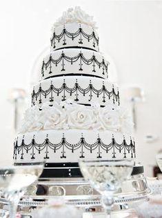 Elegant black and white wedding cake decorated with roses. Keywords: #blackandwhiteweddings #weddingcakes #jevelweddingplanning Follow Us: www.jevelweddingplanning.com  www.facebook.com/jevelweddingplanning/