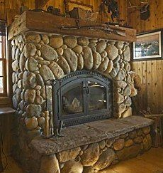 Custom stone fireplace hearth ideas come from a long and rich legacy of stone fireplace design . with no shortage of fresh and innovative ideas for new designs! Cottage Fireplace, Farmhouse Fireplace, Fireplace Hearth, Fireplace Surrounds, Primitive Fireplace, Fireplace Ideas, River Rock Fireplaces, Rustic Fireplaces, Stone Fireplaces