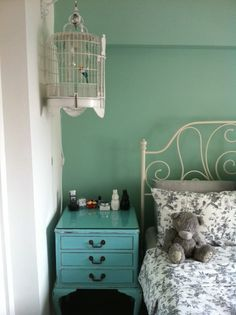 tiffany blue and white. love how the bird cage is hung from the wall.