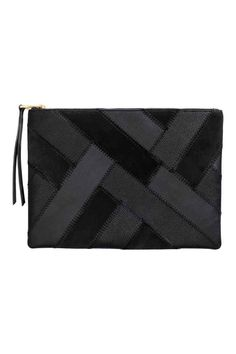 Clutch bag with suede details: Clutch bag in grained imitation leather with real suede details, a zip at the top, a patchwork front and one zipped inner compartment. Lined. Size 22x31 cm.