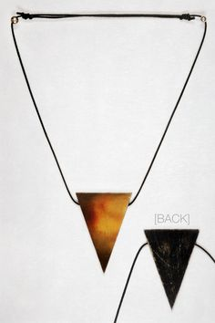 -SOLD- Flaming Heart | One of the first ever finished triangle Woodography  Necklaces with a hand transferred fragment of an unreleased photography on triangular wood with black back painting and adjustable waxed cotton cord. A very special piece for me!