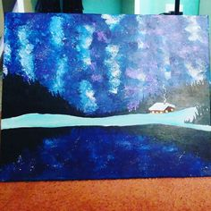 The night sky redlecing on a lake with a log cabin by sam.hymer
