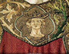 Head of a prince or king, detail from the Eagle Dalmatica, worn for the coronation by Emperors of the Holy Roman Empire. Chinese damask, purple silk embroidery. c 1300 Inv. XIII 15