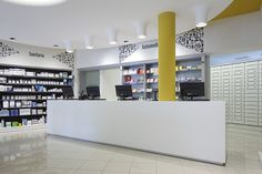 In Pharmacy Zerbini (Italy) everything is based on a game of contrast between black and white, straight lines and curvilinear elements, in a timeless encounter that combines classic and modern, in a synthesis able to highlight the professionalism and quality of the pharmacy's services.