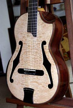 Original Da Vinci Series Bellucci guitar with quilted maple top.