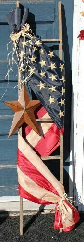 Ladder wrapped with American flag home decor.
