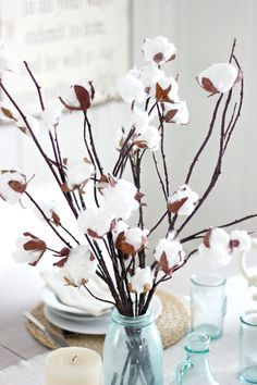 These faux cotton branches add a touch of rustic elegance to your decor. Made with recycled egg cartons, cotton and branches.