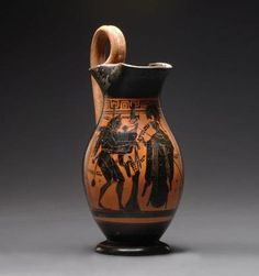Greek Archaic black-figure Olpe with Herakles Mosikos and Athena. Geometric to Archaic, Greek World, Late 6th Century B.C. The piece is whole and very well preserved. The piece is whole and very well preserved