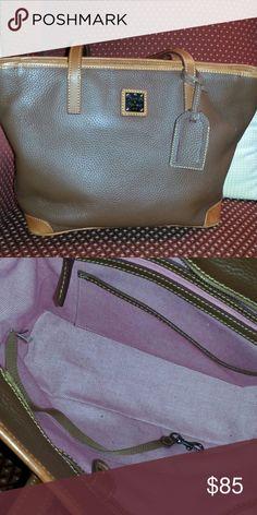 "Dooney & Bourke Pebble grain Charleston shopper. One outside zipper pocket. Two inside pockets.  One inside zip pocket. Handle drop length in 9"". Key hook on the inside. Beautiful brown color. Great bag in great condition.  This is a steel. Dooney & Bourke Bags Shoulder Bags"