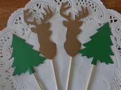 "Large Deer Head and Evergreen Tree Cupcake Toppers - Food Picks - Party Picks - Lumberjack Appetizer Picks - Hunter Party - Buck - Stag (Set of 12). 12 Deer and Tree Cupcake toppers / food picks! Amount: 12 picks size: approx. 5 inches tall total / Deer is 3 inches tall. The tree picks is 4 1/2"" tall - the tree itself is 2"" tall and 2"" wide at the base of tree. Double sided - like all of my food picks ~ so they look great from all sides! The key to a great party is in the details! These…"