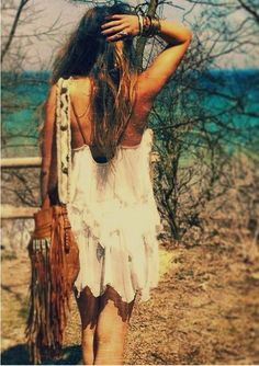 #freepeople modern hippie fashion, boho chic style feminine layered white mini dress, bohemian leather fringe purse. For MORE gypsy looks FOLLOW http://www.pinterest.com/happygolicky/the-best-boho-chic-fashion-bohemian-jewelry-gypsy-/ now