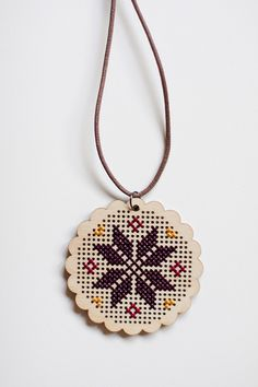 Cross Stitch Wood Pendant - just snapped up a few of these from @ThePlaidBarn for a ridiculous discount (two rounds and two chevrons), got big plans for these babies!