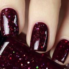Deep red sparkly nails..a must for xmas!  Available from -  Red Carpet Nails.com