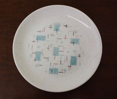This vintage 1950s Vernonware salad plate in the Heavenly Days turquoise and pink geometric pattern that just screams Mid Century Modern.