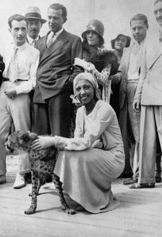Josephine Baker hanging out with her pet cheetah in 1931. The cheetah's name was Chiquita.
