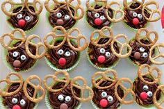 Rheindeer cupcakes for the School Christmas Fete. Wilton eyes, Gold mist pretzel antlers and Smartie noses...yum!