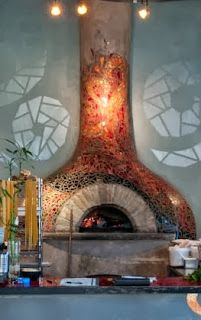 The brick oven covered in a tile mosaic at West First Wood-Fired in Hendersonville, NC