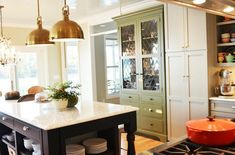 """Four different colors of wood and 4 different metal finishes. This definitely adds interest to the space. So often, people get wrapped up in making sure everything """"matches."""" If you're not careful, matching can lead to a very boring room."""