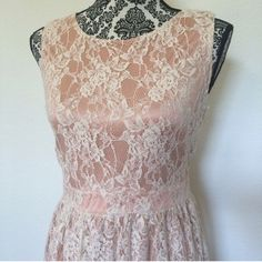 """Beautiful champagne colored dress with cream lace Gorgeous dress for day or night! Band at waist gives a figure flattering look. The inside tag is damaged (shown), but the dress is in great condition. Tons of stretch for comfy fit!  Size M Bust 34"""" (can stretch a lot ), Length 33"""" Previously owned, still in good condition Forever 21 Dresses"""