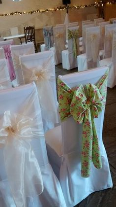 Fab idea - mismatched floral sashes made a real statement at this Spring wedding at Ufton Court.