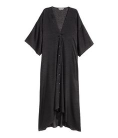 Black. V-neck kaftan in woven fabric with a burn-out pattern. Heavily dropped shoulders, buttons at front, and short, wide sleeves. Shorter at front.