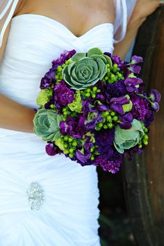 this flower bouquet makes me seriously consider wearing my purple and lime green running shoes at my wedding....