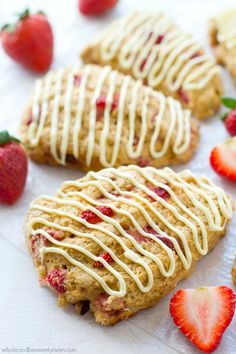 Loaded with big chunks of juicy fresh strawberries and drizzled with melted white chocolate, these ultimately-flaky scones will steal the show at your Mother's Day brunch! @WholeHeavenly