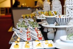 """Carlson Wagonlit Travel """"Thrive in Retro"""" Event - Served in spoons, on square plates, and in decorative bowls, menu items included deviled eggs, Caesar-salad spring rolls, and B.L.T.-stuffed tomatoes."""