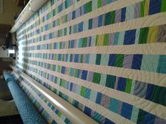 Try this math problem: What's 90 pieces per row multiplied by 34 rows? 3,060 pieces! Take a look at this immaculate quilt made by Little House Creation's sister. The panto and colors work so well together!