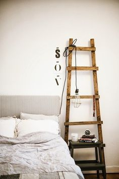 Still like using vintage ladders for shelves and hanging magazines or tomorrow's outfit.