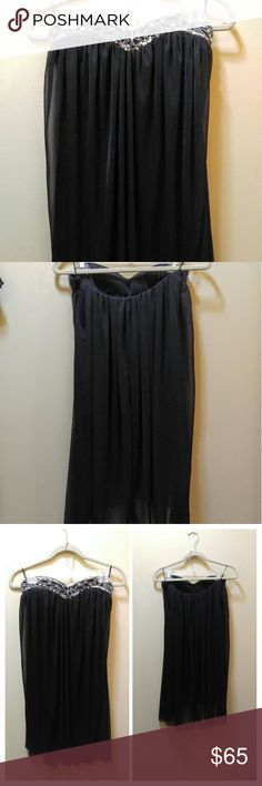 Asos strapless babydoll dress Black strapless,  has a satin underlayer and chiffon outer layer.  This dress is in amazing condition. The beadwork is tight without any signs of becoming loose. This dress will get you compliments all night. ASOS Dresses Strapless