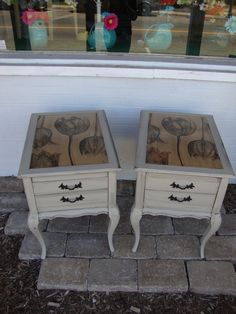 This pair of French Provincial end tables have been restored with tulip paper decoupaged on the top and the base painted in taupe with black glaze accent.
