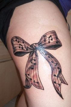 Music bow tattoo