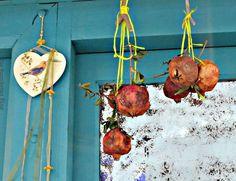 Pomegranates hanging outside a door Happy New Year theboondocksblog.com