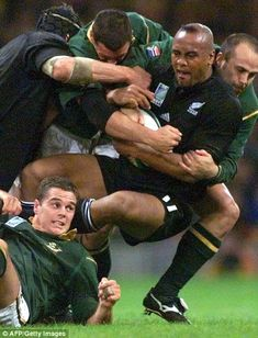 New Zealand's winger Jonah Lomu is tackled by South African's flanker Rassie Erasmus in the third place play-off match against South Africa in 1999