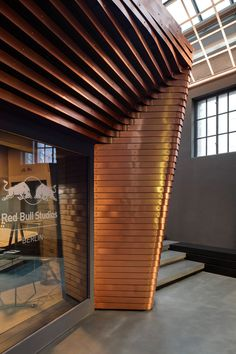 Red Bull studio in Berlin by Optimist Design is a copper-clad volume inserted into an old power station