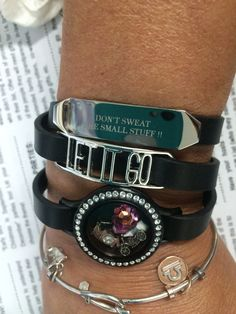 "My new triple wrap leather bracelet featuring our new In{script}ions Slider and favorite quote ""Don't Sweat the Small Stuff"" and Expression Frame ""Let It Go.""  Origami Owl new summer launch Monday 6/1!"