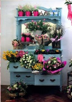 A quaint and lovely way to display flowers for sale in a flower shoppe.