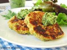 Zucchini Salmon Cakes - packed with superfoods like quinoa and salmon and served with a tasty pesto!