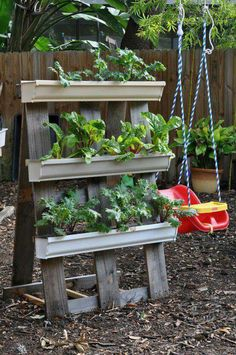 brilliant and simple DIY vertical garden solution |  Make some A-frame gutter gardens out of pallets ...for veggie vines & beans! Then grow Spinach & Romain Lettuces underneath in the shade it makes!