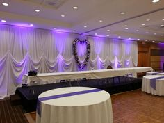 One pin scalloped backdrop with led lighting.