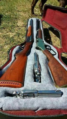 Double barrel shotgun, lever action rifle, and a pair of six shooters. Weapons Guns, Guns And Ammo, Zombie Weapons, Cowboy Action Shooting, Weapon Storage, Lever Action Rifles, Gun Cases, Custom Guns, Hunting Guns
