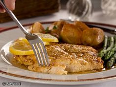 Chicken Francese -                                                                            What You'll Need:  1/2 cup all-purpose flour 1 tablespoon chopped fresh parsley 1/2 teaspoon salt 3 eggs 4 tablespoons (1/2 stick) butter, divided 6 boneless, skinless chicken breast halves (1-1/2 to 2 pounds total), pounded to 1/4-inch thickness 2/3 cup white wine or dry vermouth 4 tablespoons lemon juice