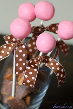 Pink cake pops with brown and pink ribbon