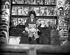 irl reading comic book in newsstand, c. 1940–1945