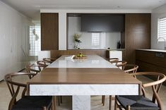 Kitchen:Modern Dining Seat With Kitchen Table With Double Functionality With Modern Kitchen Table With Marble Countertops Also Wooden Extend Kitchen Table Also Wooden Kitchen Cushion Charis And There Are Kitchen Faucet Also Use Marble Floor For Small Kitchen Smart Kitchen Designs for Small Space by Minosa Design