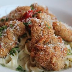 Delmonico Fried Oyster Bordelaise from Emeril Lagasse. In this Creole classic, fettucine pasta is bathed in a rich butter-garlic sauce made from a compound butter, then topped with crispy fried oysters. Oyster Recipes, Cajun Recipes, Fish Recipes, Seafood Recipes, Cooking Recipes, Haitian Recipes, Donut Recipes, Louisiana Recipes, Southern Recipes