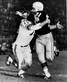 FILE - In this Sept. 4, 1962, file photo, New York Giants' linebacker Sam Huff, left,  tackles Green Bay Packers' Jim Taylor (31) during an NFL football game in Green Bay, Wis. On Saturday, the 77-year-old Huff will be honored during West Virginia's NCAA college football game against James Madison of the Championship Subdivision. (AP Photo/File)  Yeah for WVU's Sam Huff!!